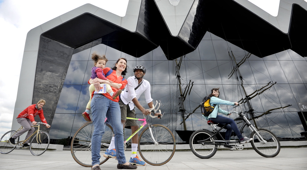 Car-Free Tourism Online Guide Launch, Glasgow, 23/06/2015: Launching an online guide for car-free tourism at Glasgow's Riverside Museum of Transport are Edinburgh mum Elspeth Wray (correct), her two-year old daughter Mae Kalambani (correct) and partner Edgar Kalambani. Photography from:  Colin Hattersley Photography - colinhattersley@btinternet.com - www.colinhattersley.com - 07974 957 388